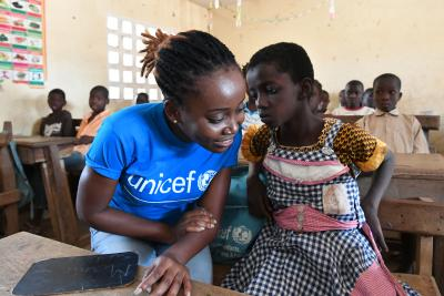 Chrystel Trazié, UNICEF Staff member listening to a girl at school in Odienné, in the North East of Côte d'Ivoire.