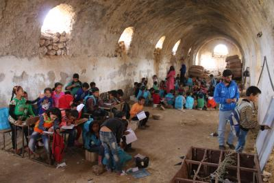 A school in a cave providing a safe environment.