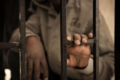 A 14-year-old migrant from the Niger rests his hand on a gate inside a detention centre in Libya in January 2017.