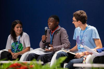 A group of youth advocates speaking on stage at the COP25 conference