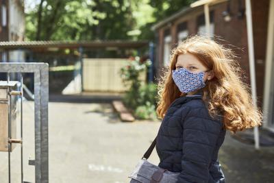 [NAME CHANGED] Hanna going to school wearing a protective mask in Cologne, Germany, on May 15th, 2020.