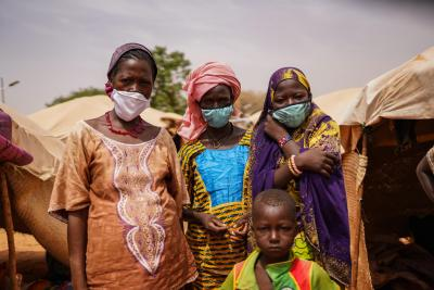 Niger. A family stand near their home.