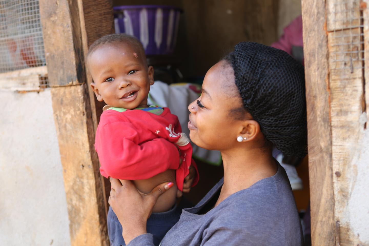 A woman smiles at her baby, Sierra Leone