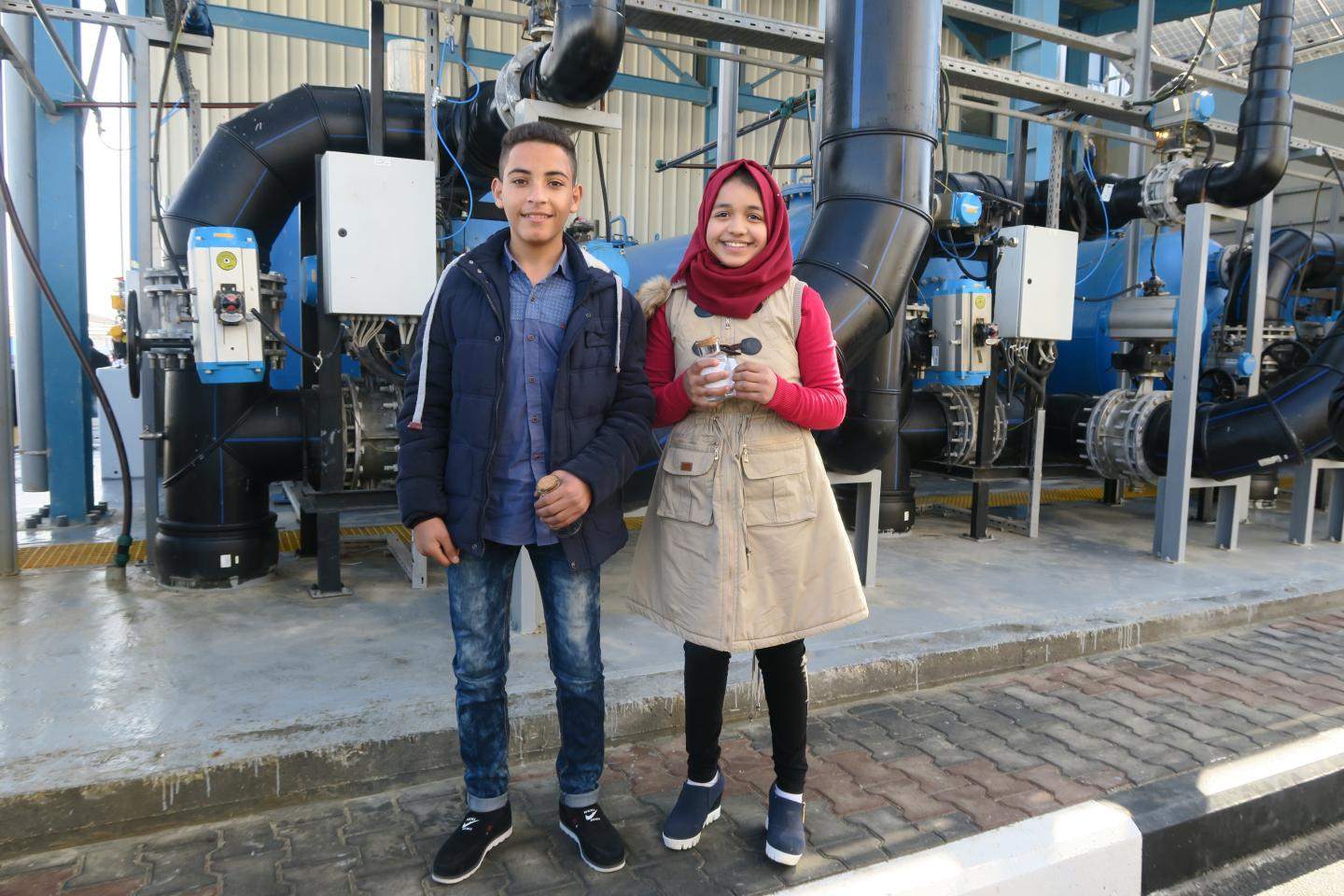 Children stand in the new seawater desalination plant, Gaza