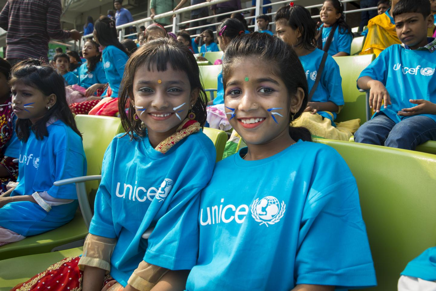 Children celebrate World Children's Day in Dhaka at a Goodwill Cricket Match organized by UNICEF Bangladesh and the Bangladesh Cricket Board.
