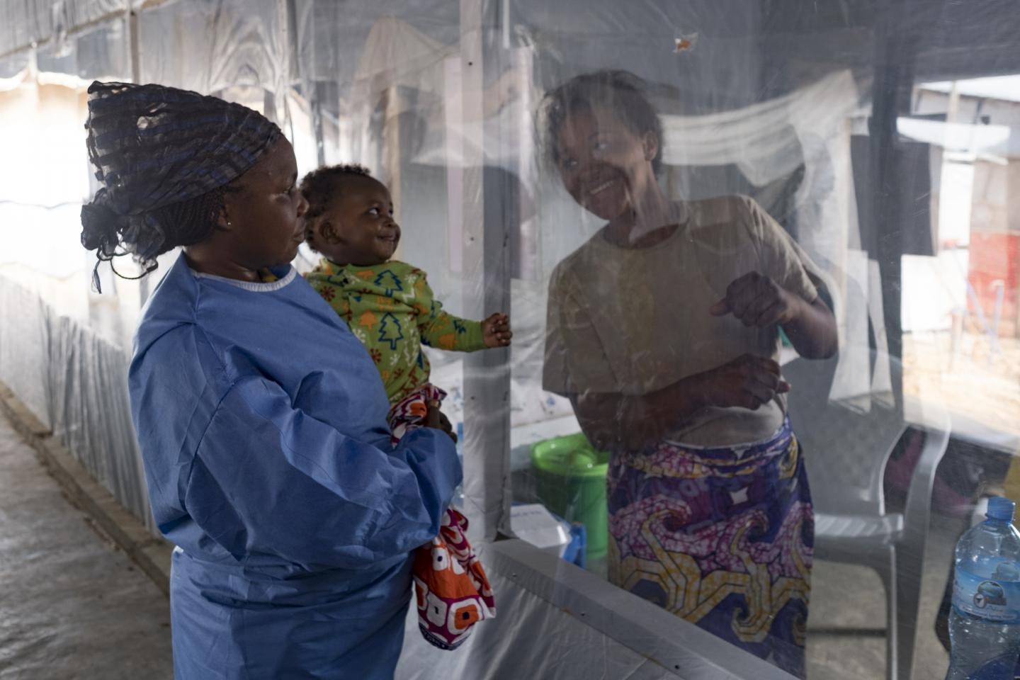 Democratic Republic of the Congo. A baby looks at his mother at an Ebola treatment centre.