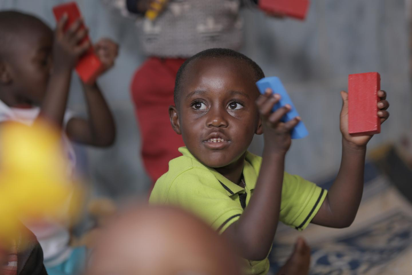 A young boy plays and learns with blocks in an early childhood development centre in Rwanda.
