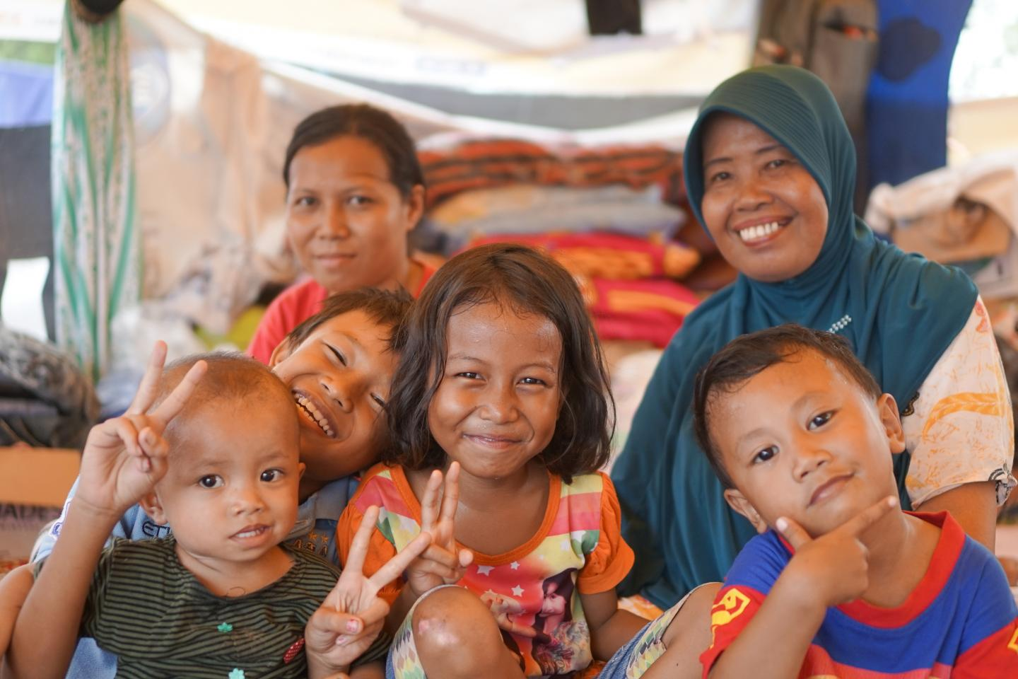 At a temporary learning pace a family calls home for the moment in Indonesia