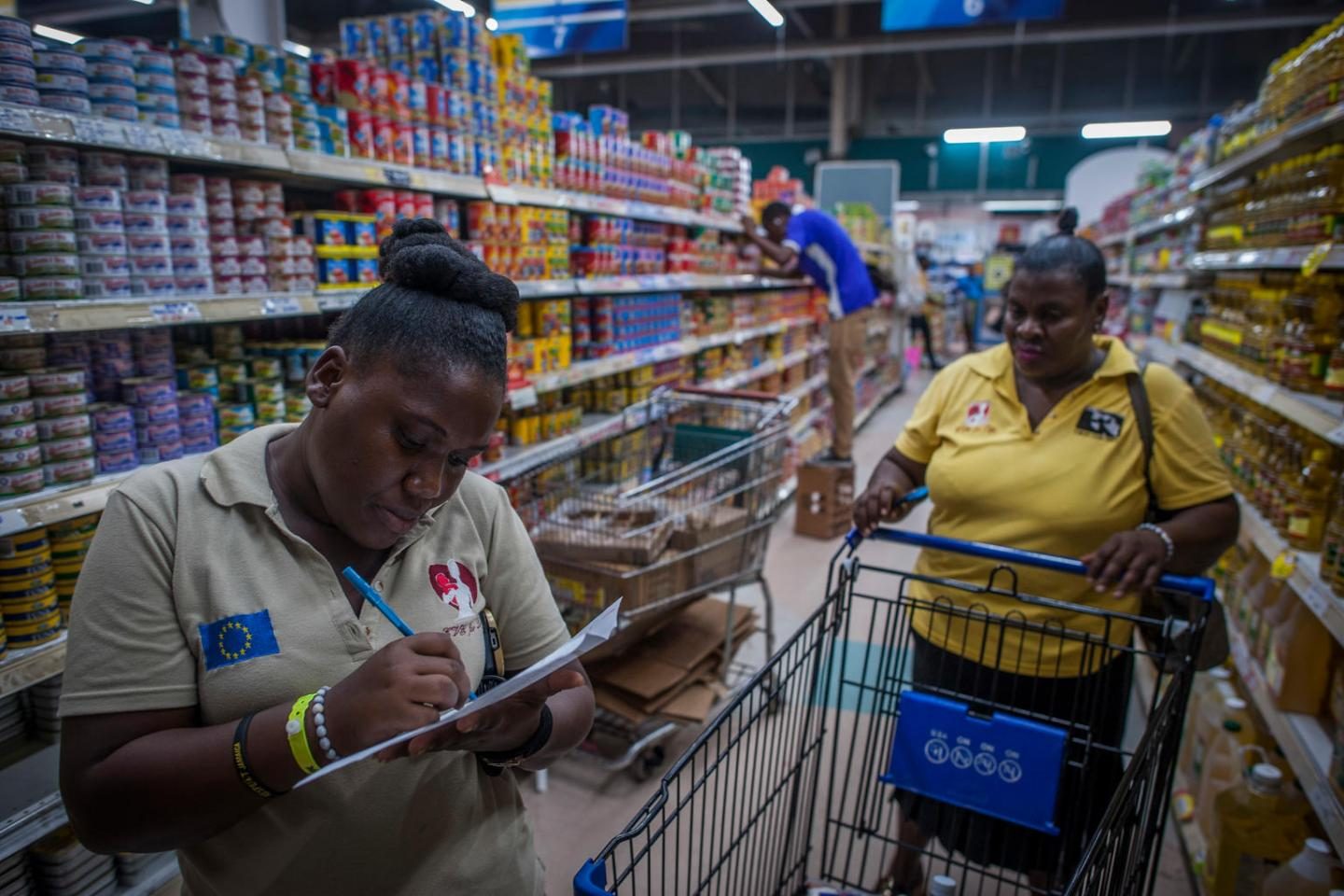 Mentor Mom Monique shops in the local supermarket in Jamaica