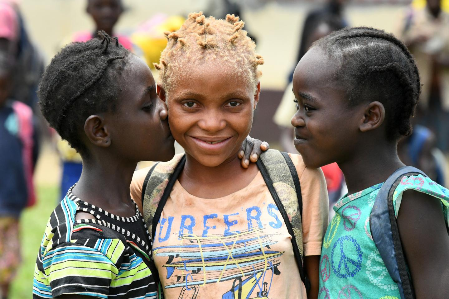 Convention on the Rights of the Child. Three girls stand together in Congo.