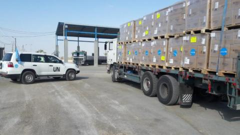 Two trucks deliver urgently needed medical supplies from UNICEF into the Gaza Strip