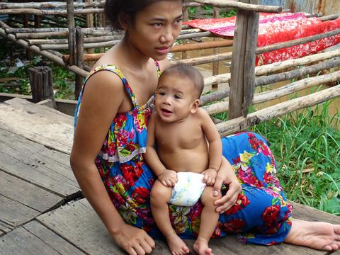 Fifteen-month-old Seiha sits in her mother Sok Chea's lap.