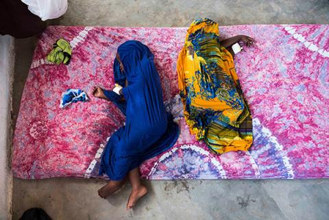 Two children sleep on a mattress, Somalia
