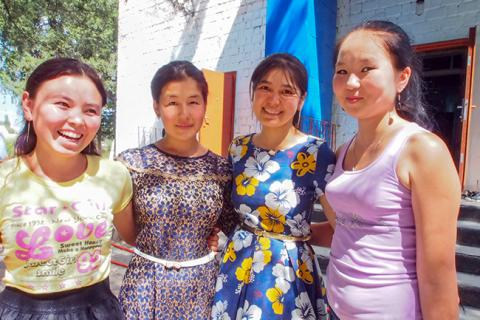 Aigerim (far left) and other girls from the Vasilevka village menstrual hygiene training team.