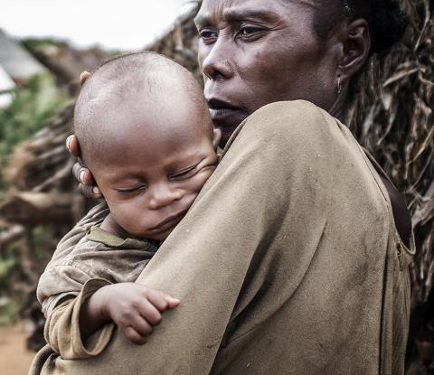 A woman holds her baby in her arms, Madagascar