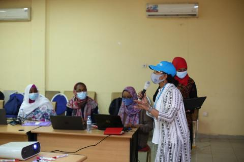 Sudan. A health worker discusses vaccines.