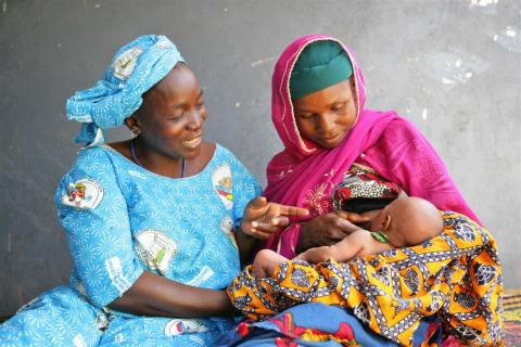 A woman breastfeeds her child, Niger