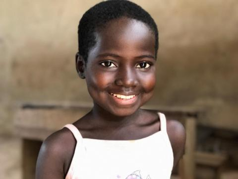 A girl smiles widely, Democratic Republic of the Congo