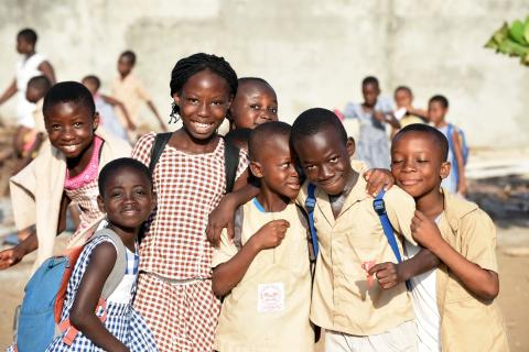 Friends walk home from school in Gonzagueville, Côte d'Ivoire.