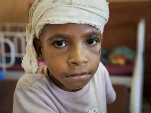 A child injured from falling rocks by Papua New Guinea earthquake