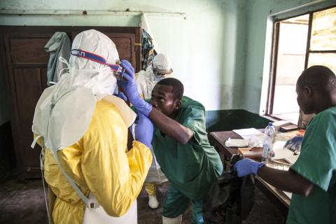 Health workers get ready to attend to suspected Ebola patients in Bikoro Hospital, the epicenter of the latest outbreak in the Democratic Republic of the Congo on 12 May 2018