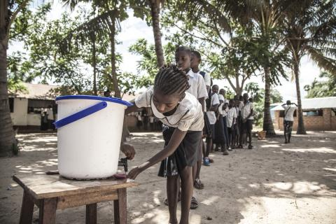 On 22 May 2018, children wash their hands to help contain the Ebola outbreak before entering a classroom in the north-western city of Mbandaka, in the Democratic Republic of the Congo. UNICEF has installed hand-washing points in 50 targeted schools in affected areas in the port city.