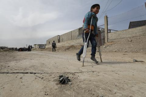 On 15 March 2018 in Beit Sawa, eastern Ghouta, boy on crutches walks towards Hamourieh where an evacuation exit from eastern Ghouta has been opened.