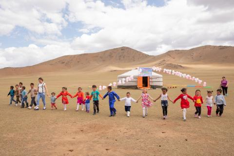 Children stand in a UNICEF funded mobile kindergarten