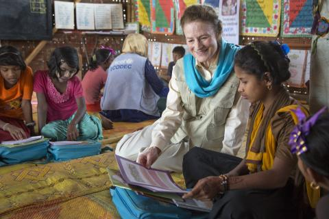 On 25 February 2019 in Bangladesh, (left) UNICEF Executive Director Henrietta Fore speaks (right) Rukaiya,11, at the Learning Centre Shikhon in the Camp 18 section of the Kutupalong-Balukhali mega-camp in the Cox's Bazar district. Rukaiya wants to be a teacher; she loves teaching others. She likes friends, teachers and classroom activities, especially interaction with her teacher, when she can give her opinion and feels it is valued. English is her favourite lesson.