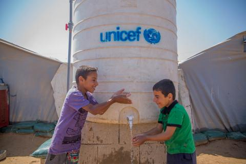 """We can't image out lives without water. It's really good that we have a water tank next to our tent."" Mujbal and Mutaab are brothers who have been displaced from Al-Qaim, near the Syrian border, for almost a year."