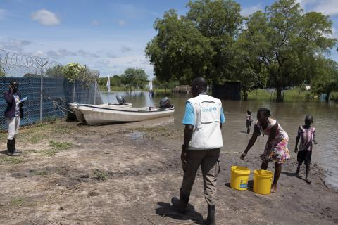 A UNICEF staff member with children in flood-affected Pibor Town, South Sudan