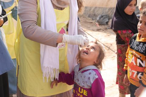 Maisa, 3, receiving oral polio vaccine (OPV) in Al-Hol camp, northeast Syria, as part of a five-day national immunization campaign aiming to reach 2.7 million children across Syria.