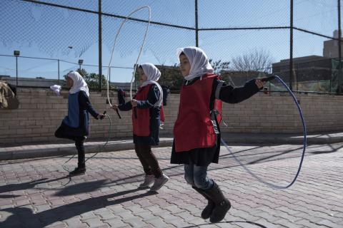 FILE PHOTO: Students skip rope in a playground at El Hadana school in Zanzur, east of Tripoli, Libya, Thursday 2 February 2017.