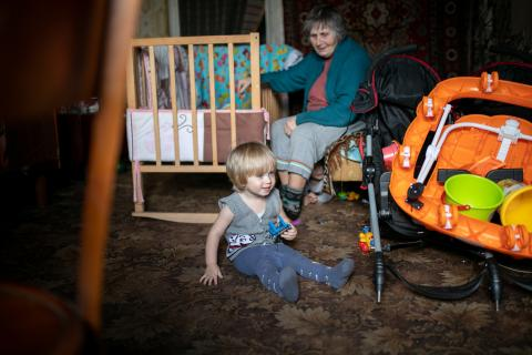 Two-year-old Dariy with his grandmother in their home in Krasnohorivka, eastern Ukraine.