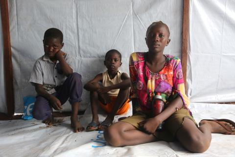 A girl sits with her two brothers, South Sudan