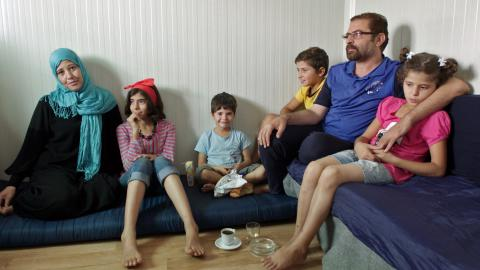 A family sits on a couch, Greece