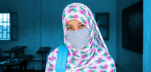 A young student wearing a face mask, because of the covid-19 pandemic.
