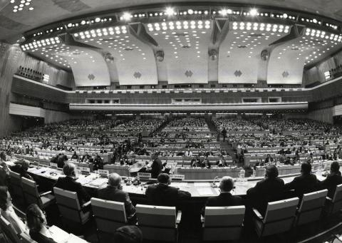 A fish eye lens view of a filled conference hall