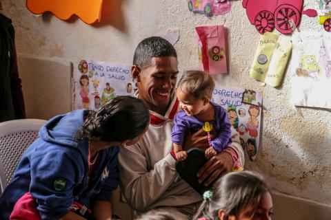 Parents and children at a UNICEF-supported Child Friendly Space in Rumichaca, on the Ecuadorian side of the border with Colombia. UNICEF has launched a regional response to support children and families from Venezuela, as well as children in host communities.