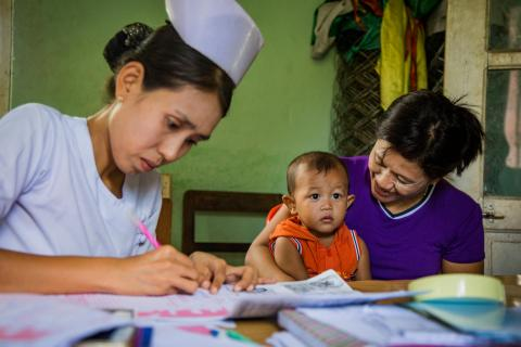 A nurse registers Wunn Yan Kha at the Nation Birth Registration Campaign Naypyidaw