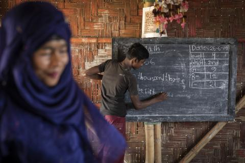 Rozina Akta (foreground), 22, teaches level 4 students at the UNICEF-supported Learning Centre in Camp 4 of the Kutupalong-Balukhali mega-camp, Cox's Bazar, Bangladesh.