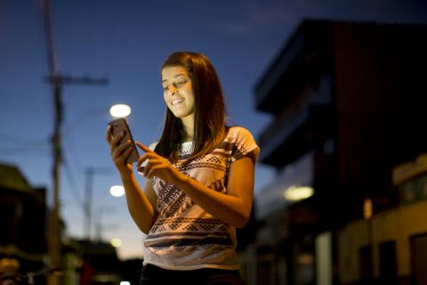 On 30 March 2016, 17-year-old checks her mobile phone on the street in Taiobeiras municipality in Brazil. Winny supporting her friend, became an advocate against online sexual exploitation and cyberbullying.