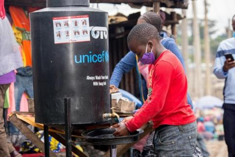 Kenya. A boy washes his hands.
