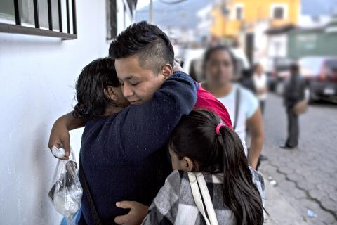 A family embraces, Guatemala