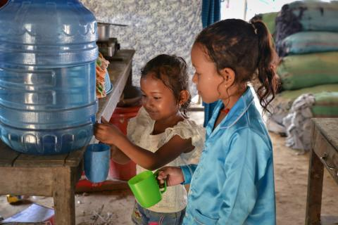 Mara, 5, and Nisa, 8, are no longer afraid of drinking water. Since UNICEF's intervention to bring water supply to their home in Bateay District, their family is having few health issues.
