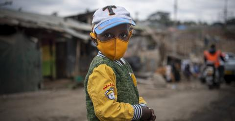 A sub-saharan African child with his mask