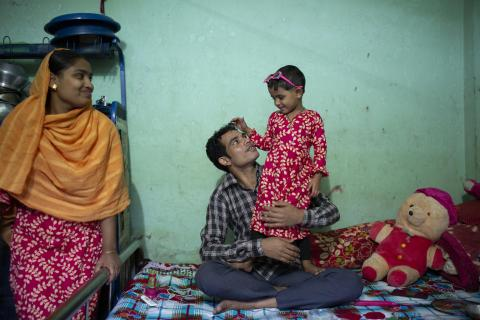 26-year-old Jamal, pictured with his 30-month-old daughter, Jui, works at a garment factory in Gazipur, Bangladesh.