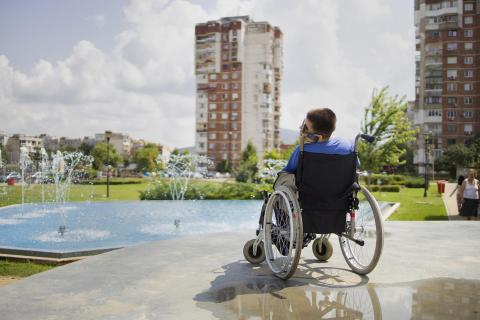 A girl in the park, sitting in a wheelchair in Dabnika, Bulgaria