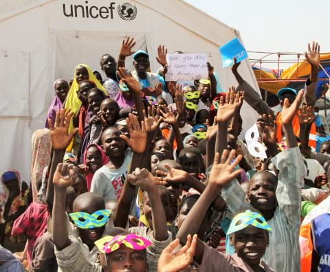 Children celebrating with UNICEF team at the Dalori camp 'Fun Day' in north-east Nigeria.