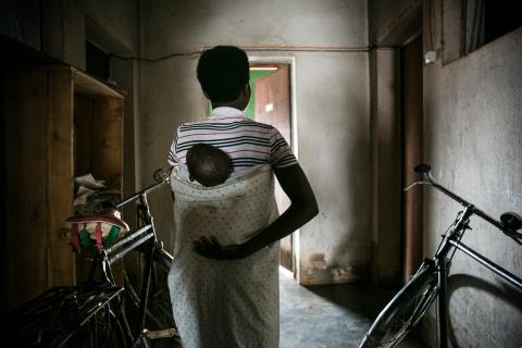 A girl carries a baby on her back, Burundi